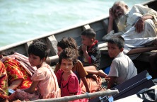 Rohingya children try to cross the Naf river in Teknaf by boat