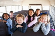 Children sitting inside school bus