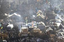People gather around tents erected by anti-government protesters in Independence Square in Kiev